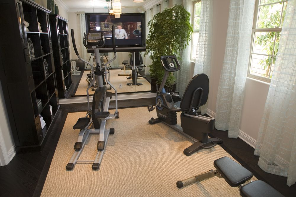 27 luxury home gym design ideas for fitness buffs recumbent exercise bike elliptical trainer Home fitness room design ideas