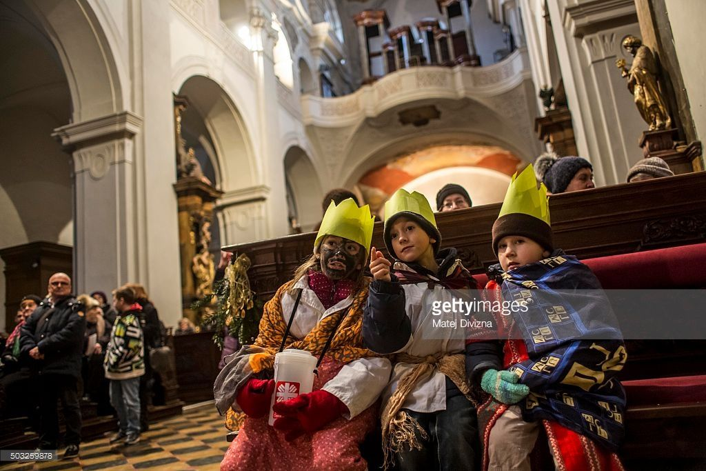 Charity carollers dressed as the Three kings attend a mass by Prague archbishop Dominik Duka before the traditional Three Kings Procession on January 3, 2016 in Prague, Czech Republic. The procession is a re-enactment of the journey made by the Three Wise Men to visit the infant Jesus, which marks the end of the Christmas festivities in Prague.