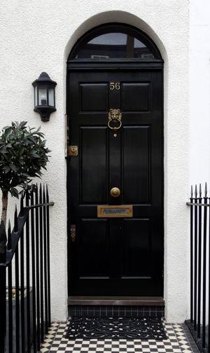 Black London door with brass door furniture. Classic look. Photo ...