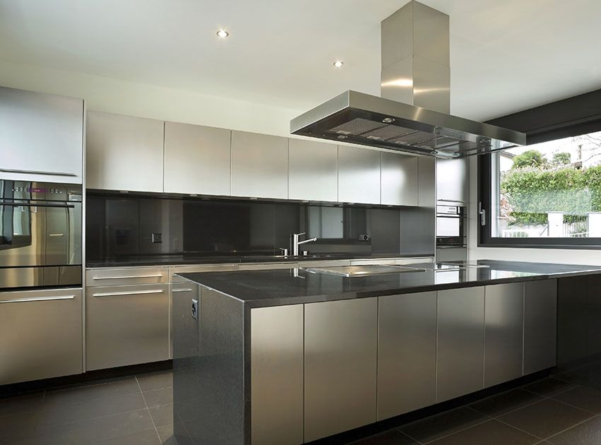 Modern Kitchen With White Cabinets Dark Gray Countertop And Backsplash