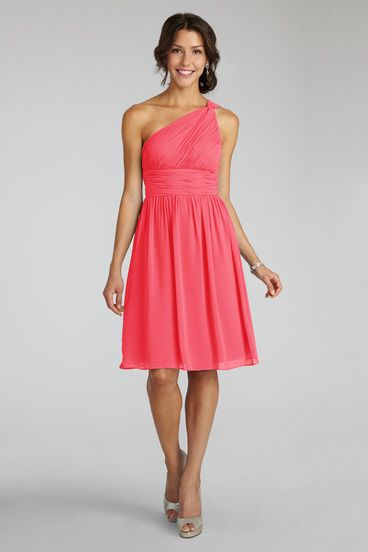efd564fbe90f Subtle ruching highlights this flowy one shoulder honeysuckle chiffon dress  with a flattering set in waist.