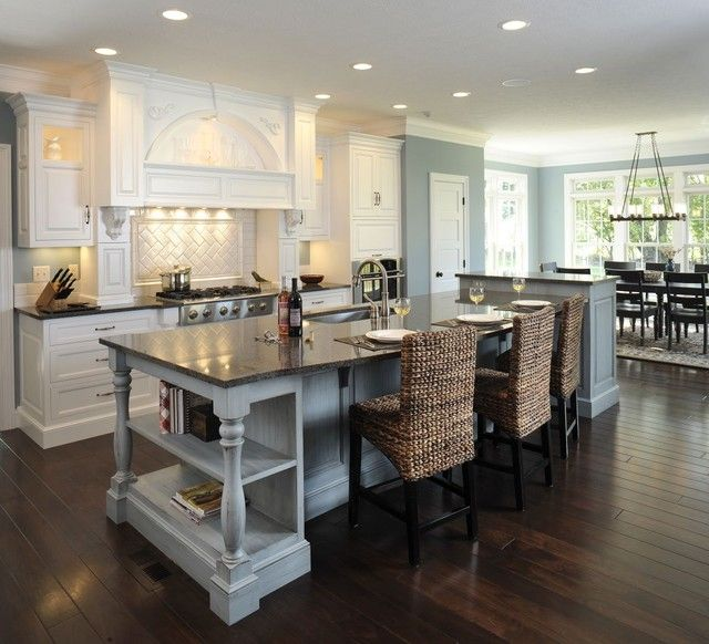 Formal White Kitchen With Blue Island
