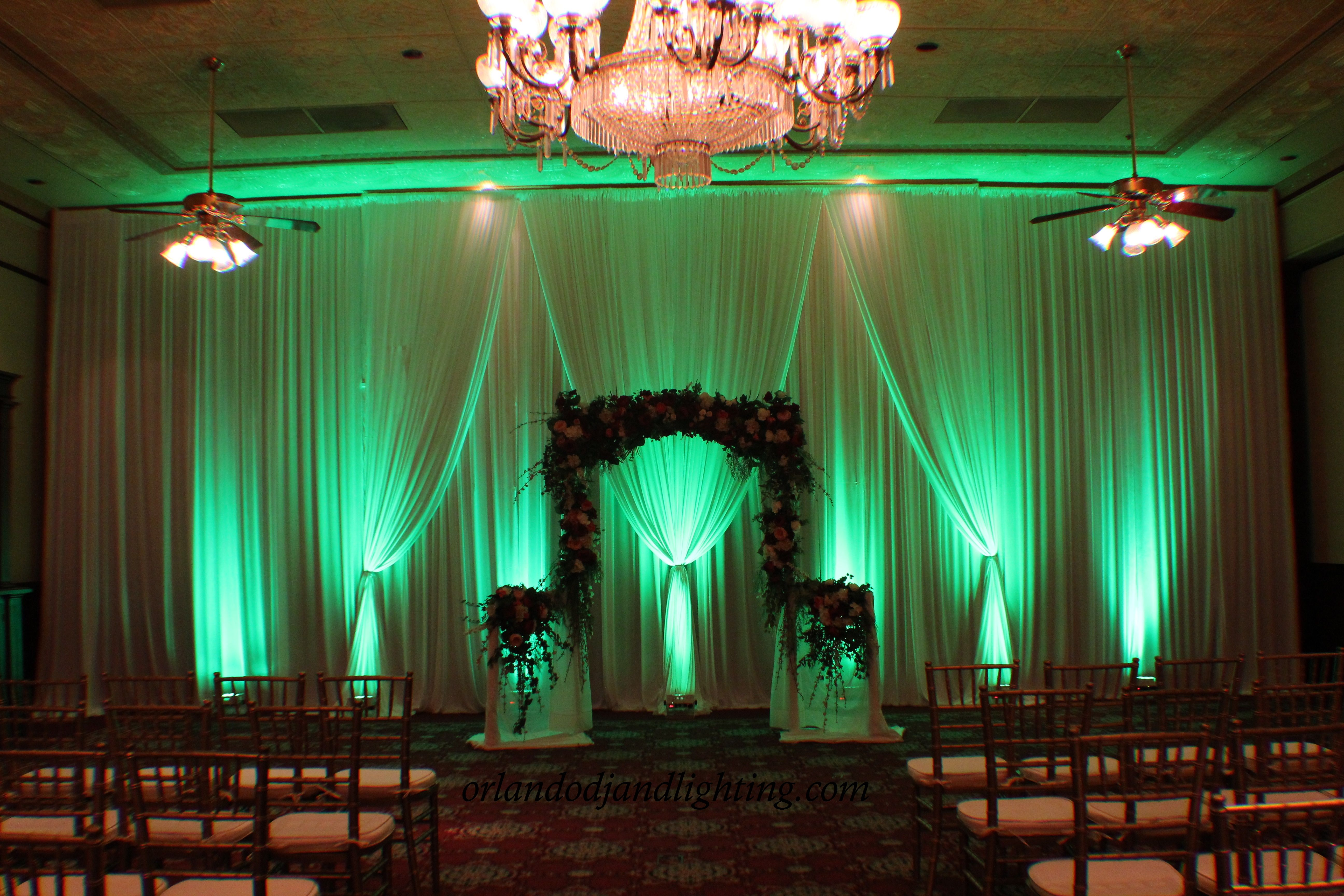Columns ivory fabric uplighting wedding ceremony downtown double tree - Stunning Ceremony Backdrop Draping Accented With Mint Green Uplighting Constructed By Orlandodjandlighting Com At