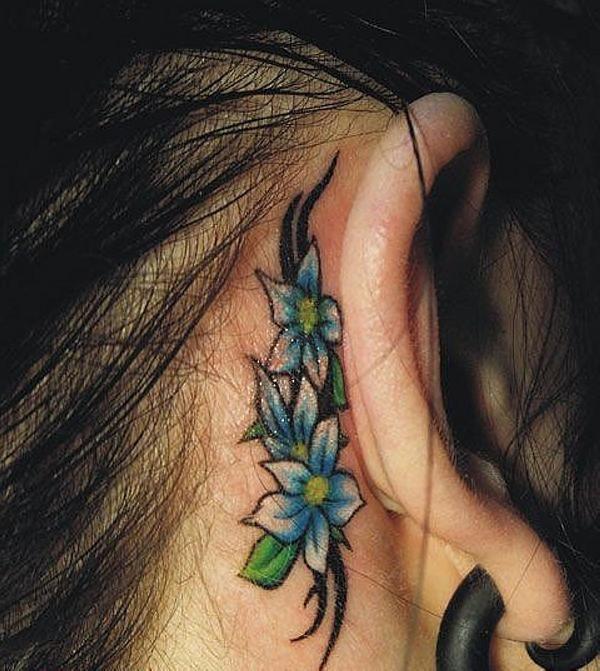 Tribal Flowers Behind Ear Tattoo