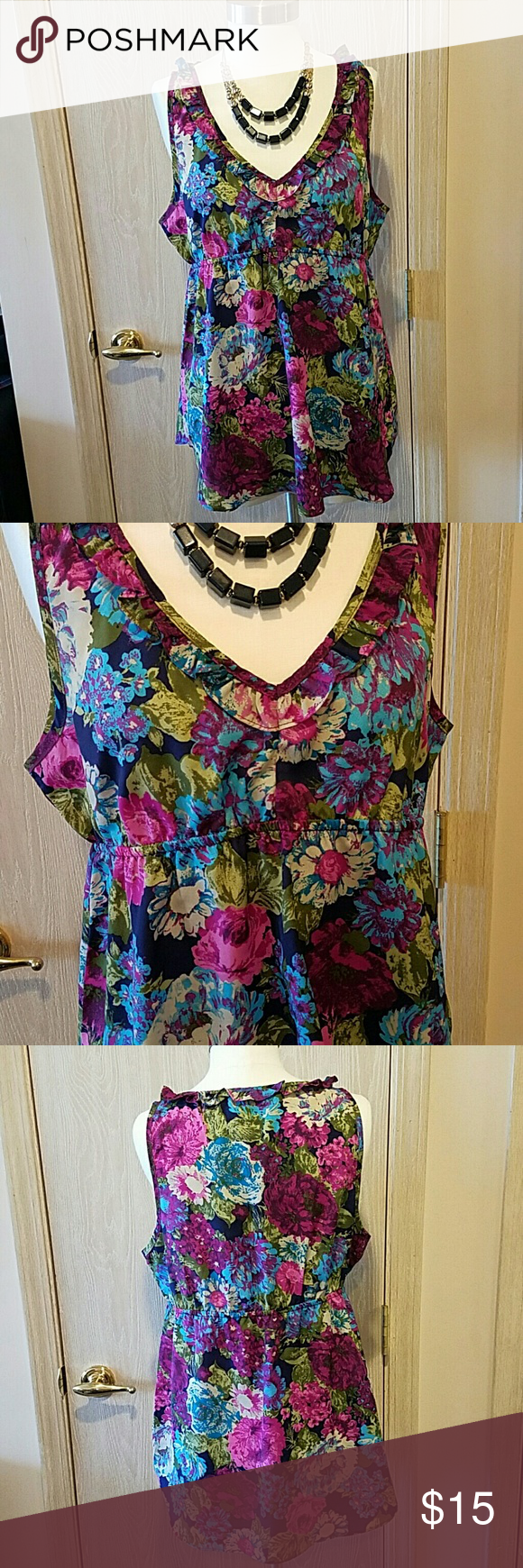 Floral tank Brightly colored floral tank top. Elastic around waist. Fits loosely.  Lightly worn but no snags or damage. Animal and smoke free home. Forever 21 Tops Tank Tops