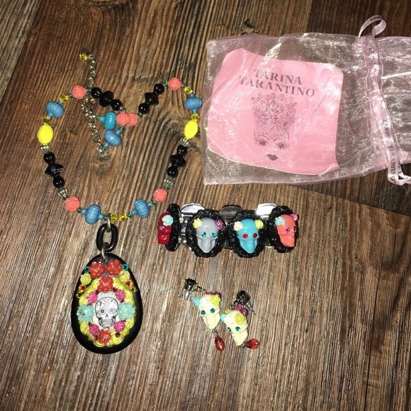 Tarina Tarantino gothic candy skull set necklace Full set of tarina Tarantino candy skill set the skeletons are missing some flowers on several of them but they look like their supposed to be like that very rare 1 pink carry bag included Tarina Tarantino Jewelry