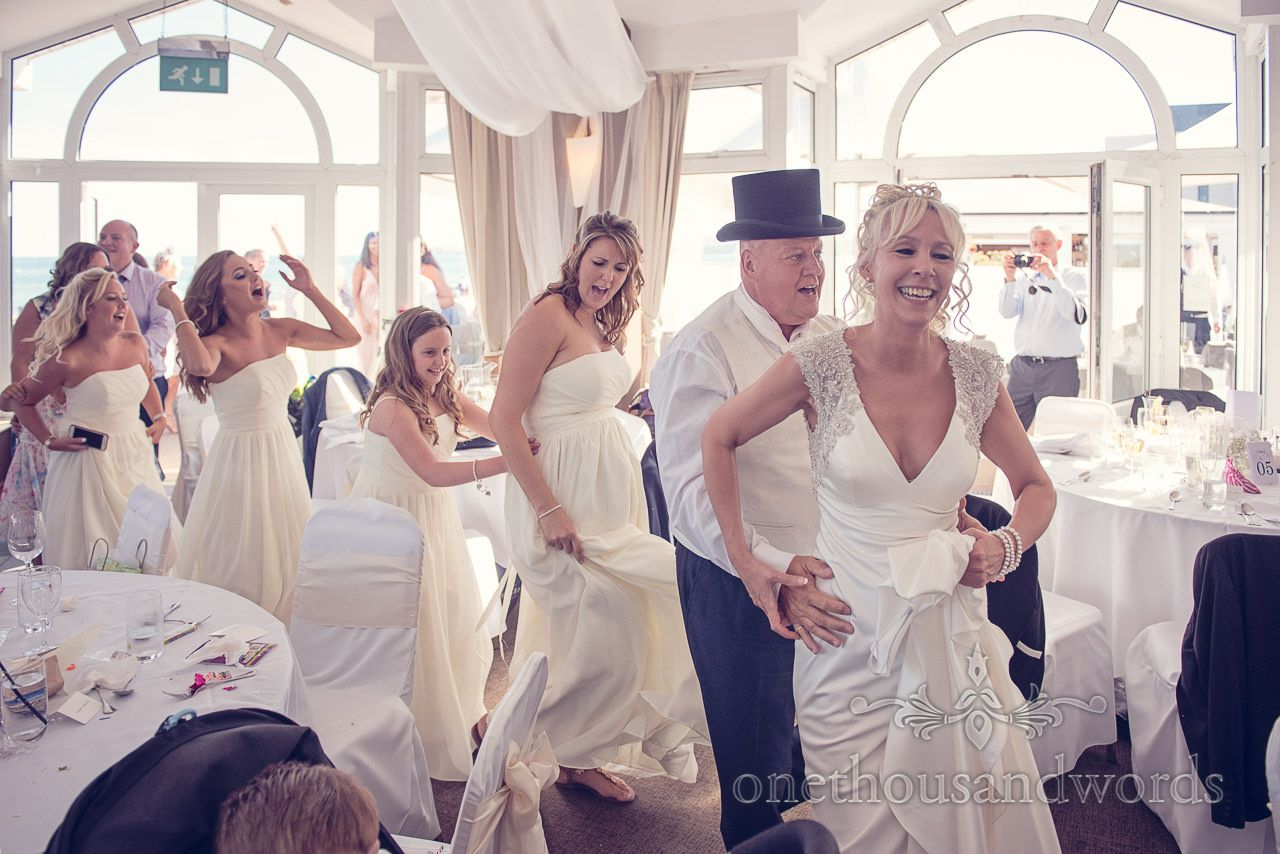 Bride Leads Conga Line At Sandbanks Hotel Wedding Photographs Photography By One Thousand Words Photographers