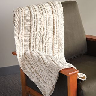 This cuddly blanket uses the same stitch patterning as our sweater and socks of the same name, but knit in Northampton Bulky, it really pops. It is just perfect for the cold days ahead of us!