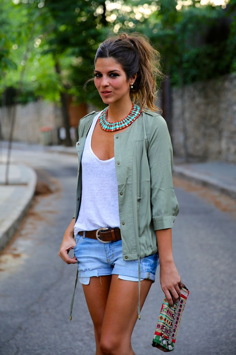 street style. jacket, denim shorts, white tee, etnic clutch