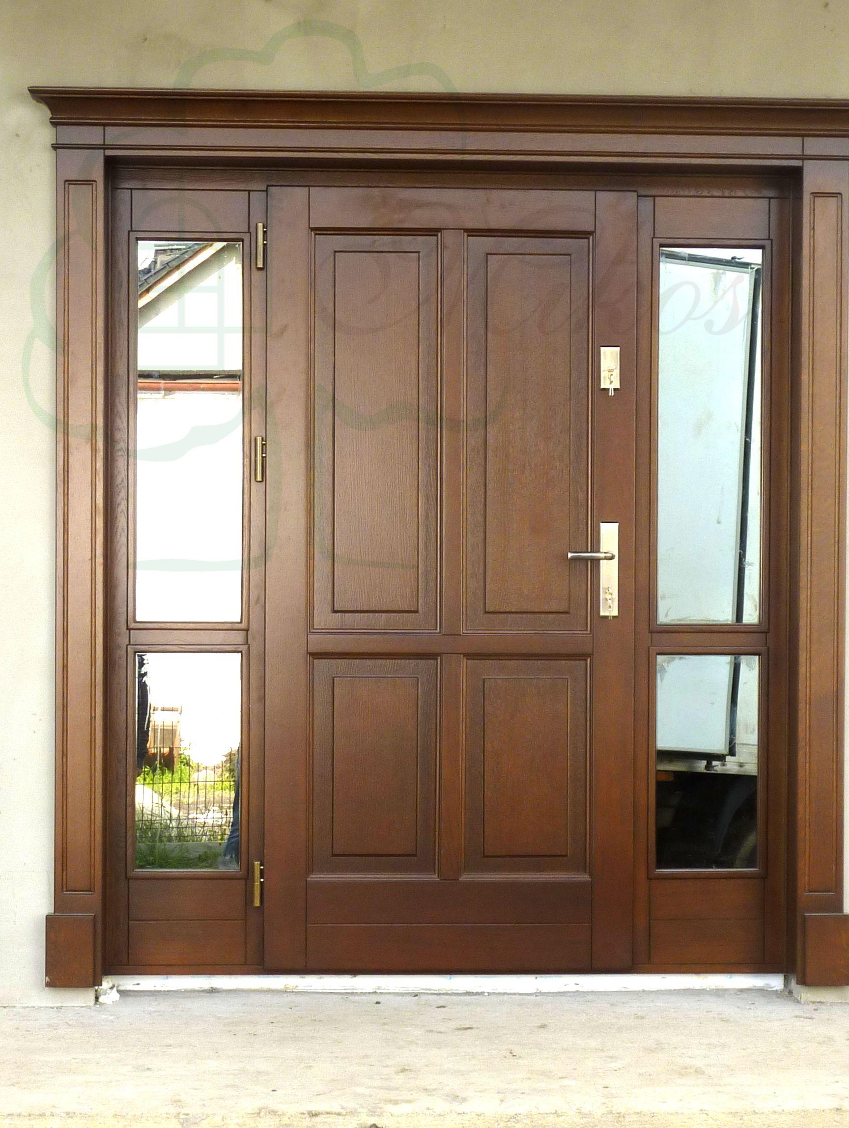 Exterior wooden door with a stylish crown, entrance door …