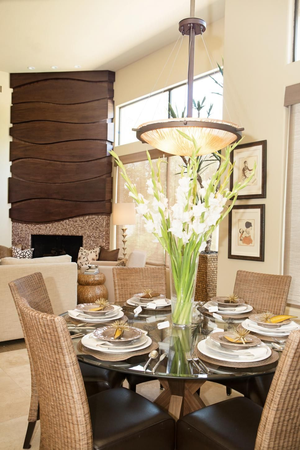 This Beautiful Dining Room Features A Circular Glass Dining Table Enchanting Circular Dining Room Table Inspiration Design