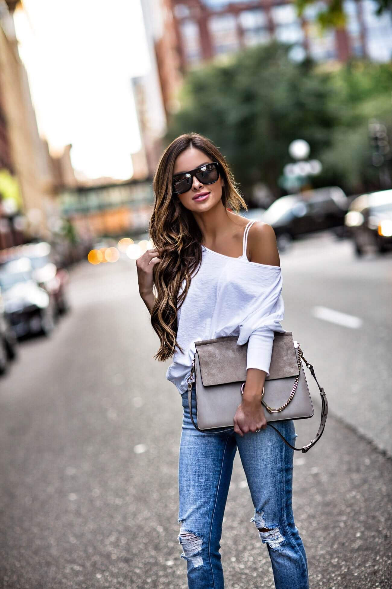9ac5dbd4e3 fashion blogger mia mia mine wearing a chloe faye bag and a white off the  shoulder top