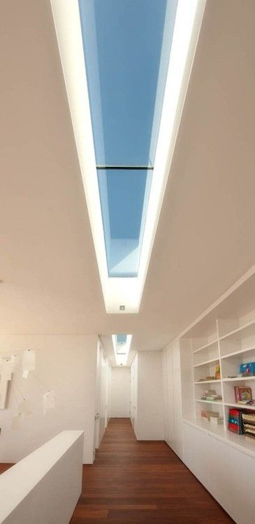 Wonderful Modern Residence Ideas by COA: Awesome Alleyway In The Big Bay  Residence With Wooden Floor And White Shelves Under Long Skylight