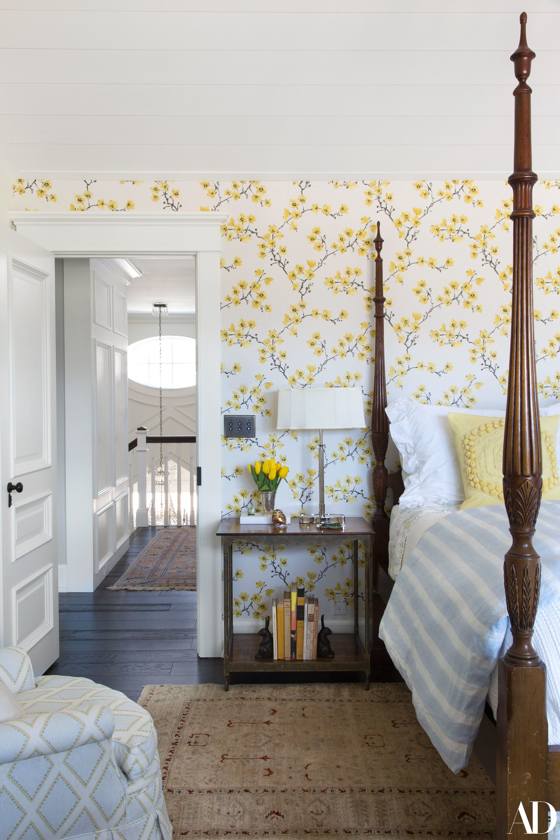 A Yellow Themed Bedroom Features Tradd Side Table Nightstands By Baker