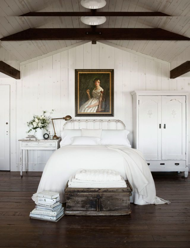 Exposed Beams Warm Up This White Bedroom Instantly