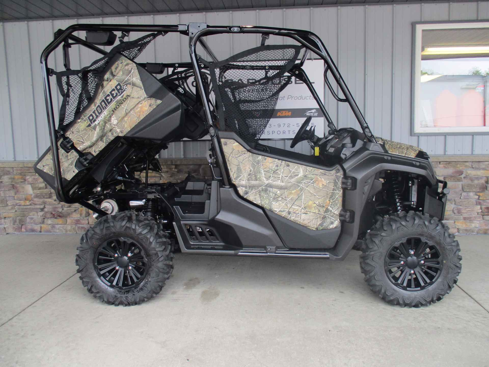"""New 2016 Honda Pioneerâ""""¢ 1000-5 Deluxe ATVs For Sale in Minnesota. GET THIS NEW 2016 HONDA PIONEER DELUXE 5 SEAT IN HONDA PHANTOM CAMO PATTERN NOW ON SALE FOR $ 15,795.00 AT CAROUSEL MOTORSPORTS IN DELANO. MSRP on this machine is $ 17,999.00 + $ 750.00 destination fees. The all new Honda Pioneer 1000 5 seat Deluxe now at the top of the UTV class!! Powered Honda's class-leading displacement in a compact engine size. The 999cc liquid-cooled inline twin utilizes the same Unicam®…"""