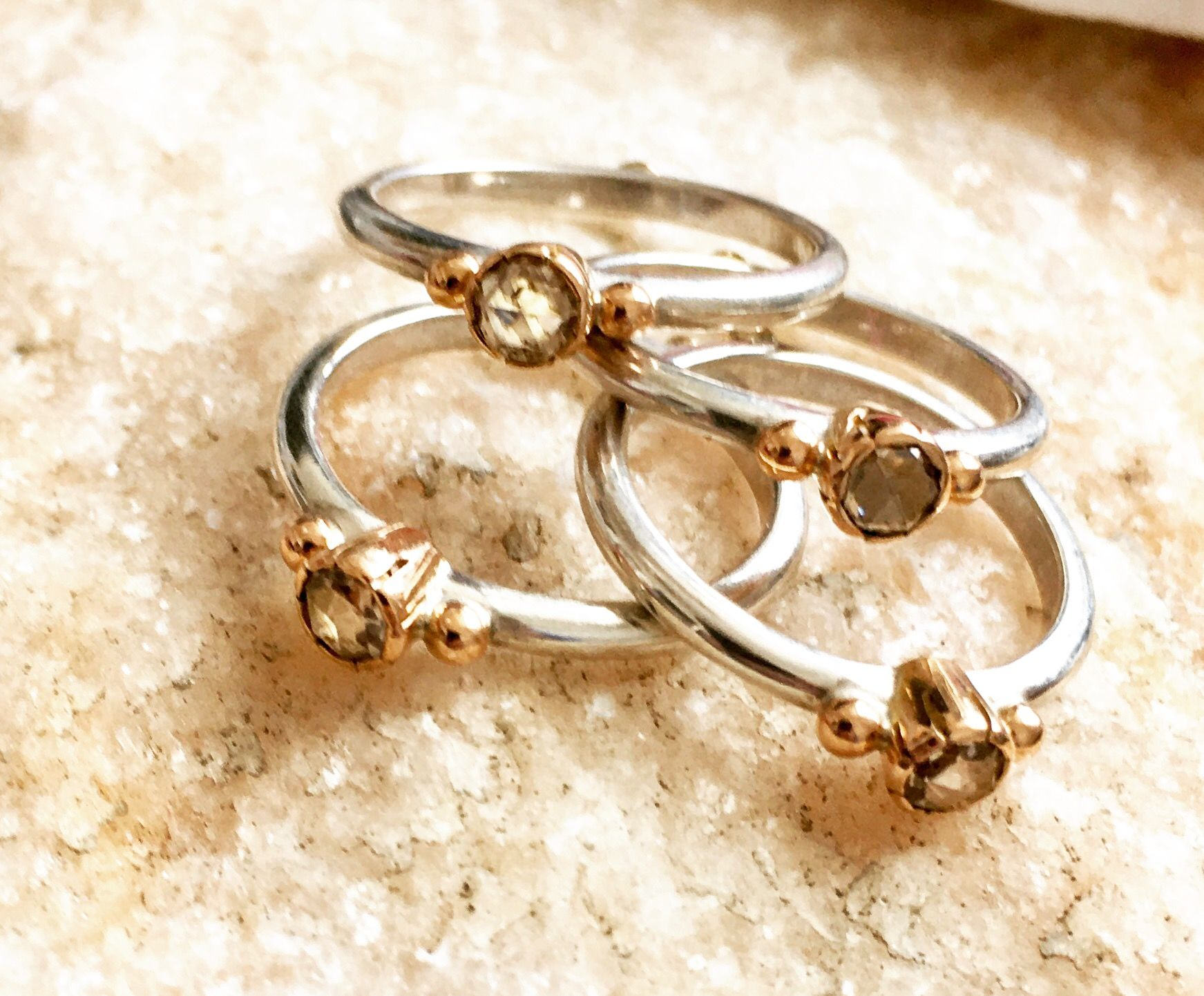 Rings of combined silver and gold set with besutiful large brown