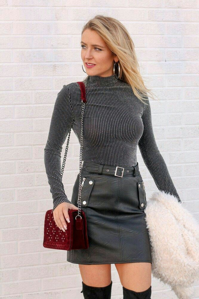 Blonde In Ribbed Charcoal Sweater And Belted Black Leather