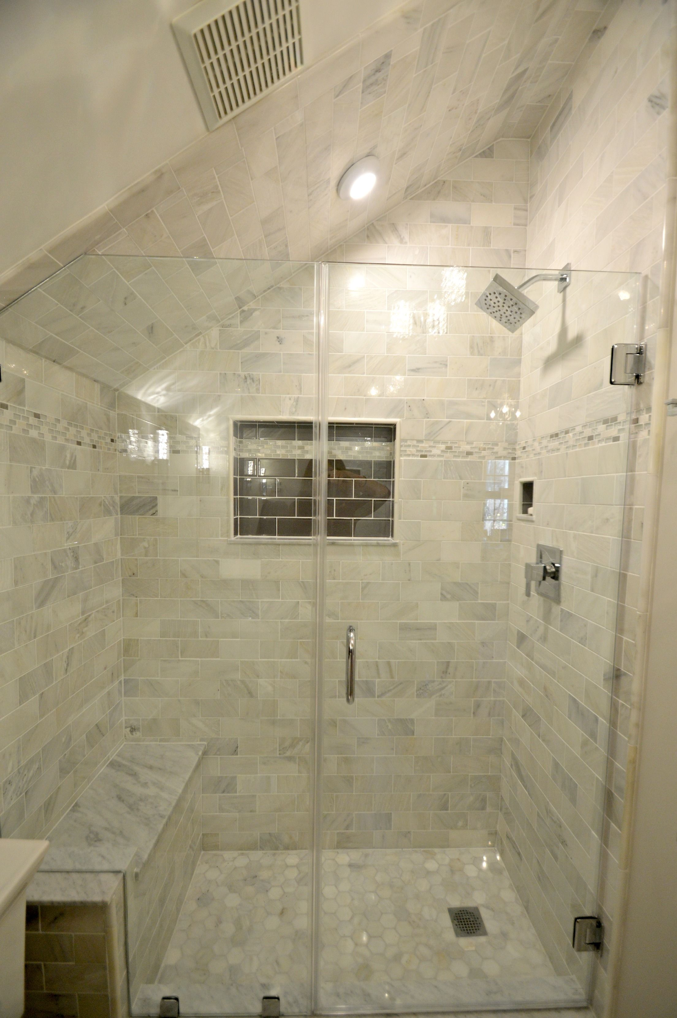 Tiny bathroom remodel features carrara marble shower with for Small bathroom with sloped ceiling