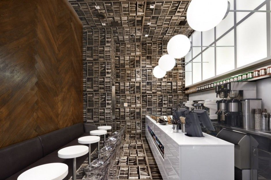 The weirdest cafe idea ever - a library on its side (photos of books  printed on tiles line the floor and run up the walls, pendant lights  protrude from ...