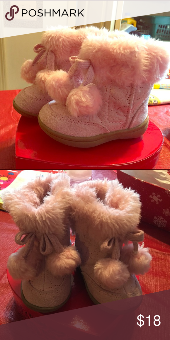 Baby pink girl boots! Super cute and still in good condition. Size 4. Have little fur balls that add the cutest touch. Shoes Baby & Walker