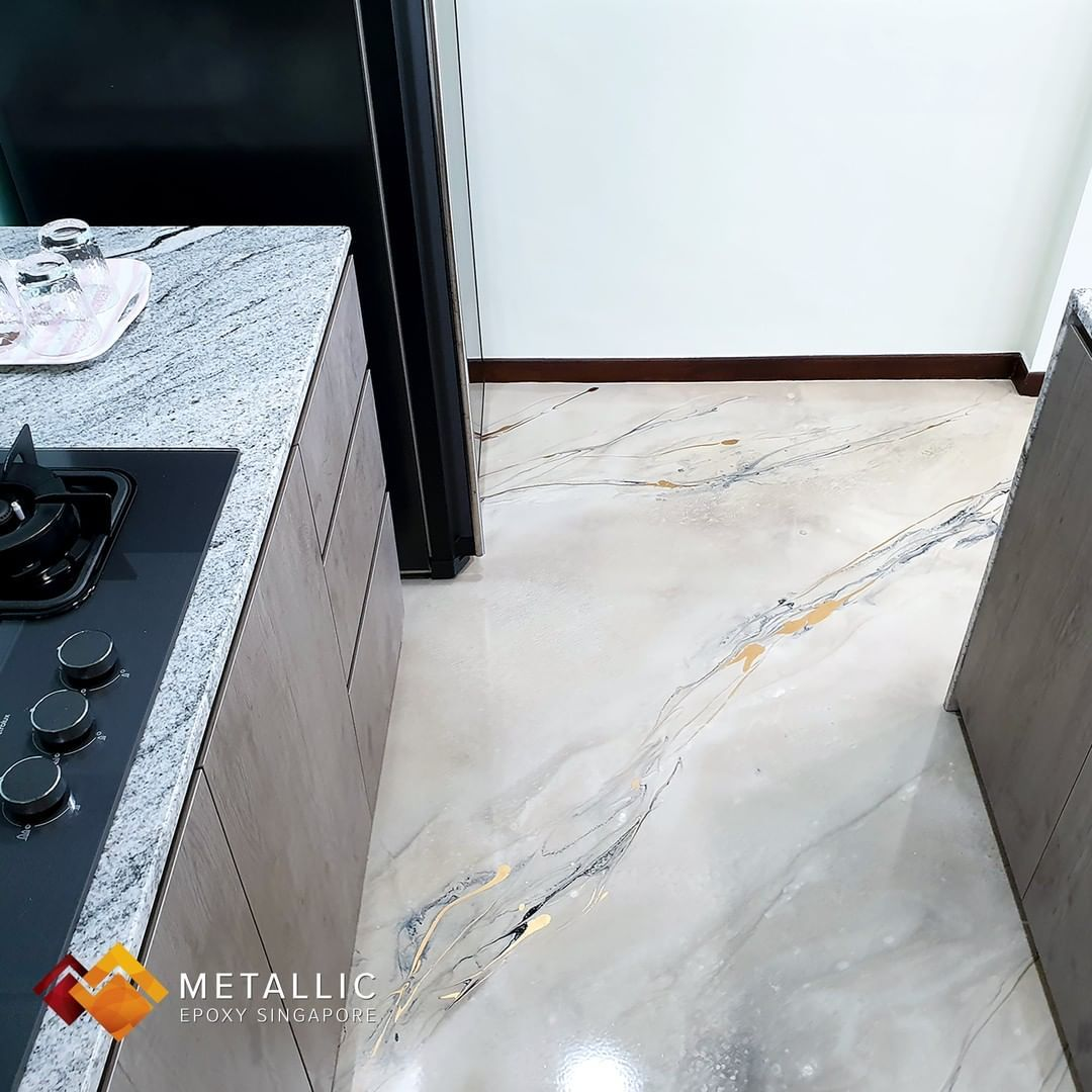 Metallic khaki base with gold and black marble veins for this home, with a simple furnishing and living room layout, making the floor stand out in a class of its own.  Metallic Epoxy Singapore can beautify your homes and work spaces. Drop us a message or head over to  to find out more!