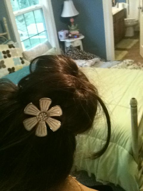 Really cool and simple sock bun! With a little flower to top it off!!