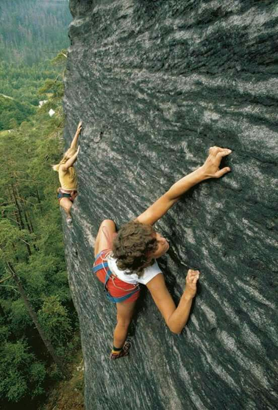 Two ladies free climbing without climbing gear