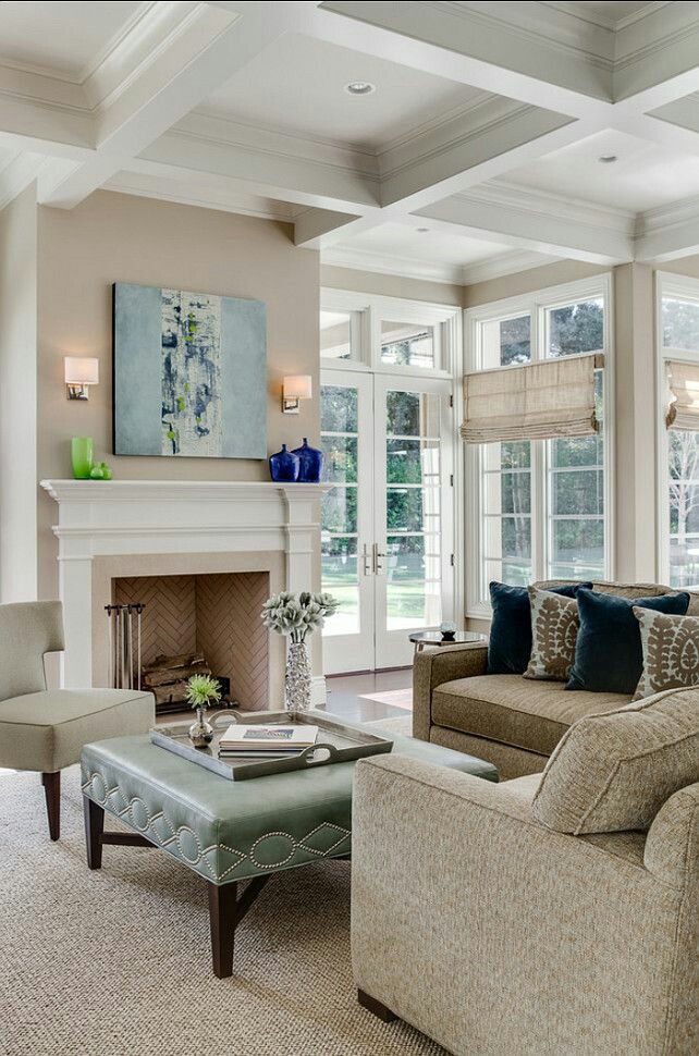 This color scheme creates a warm and inviting living room ...
