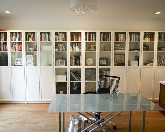 bookshelves: contemporary home office wall of book storage with