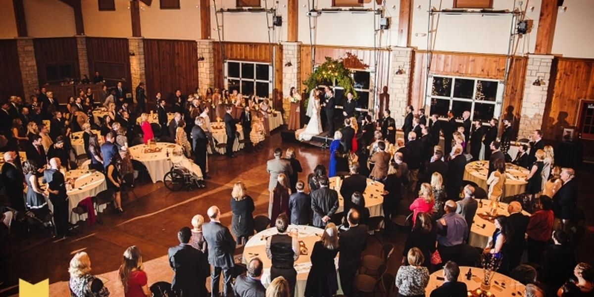 Guests at banquet tables for ceremony
