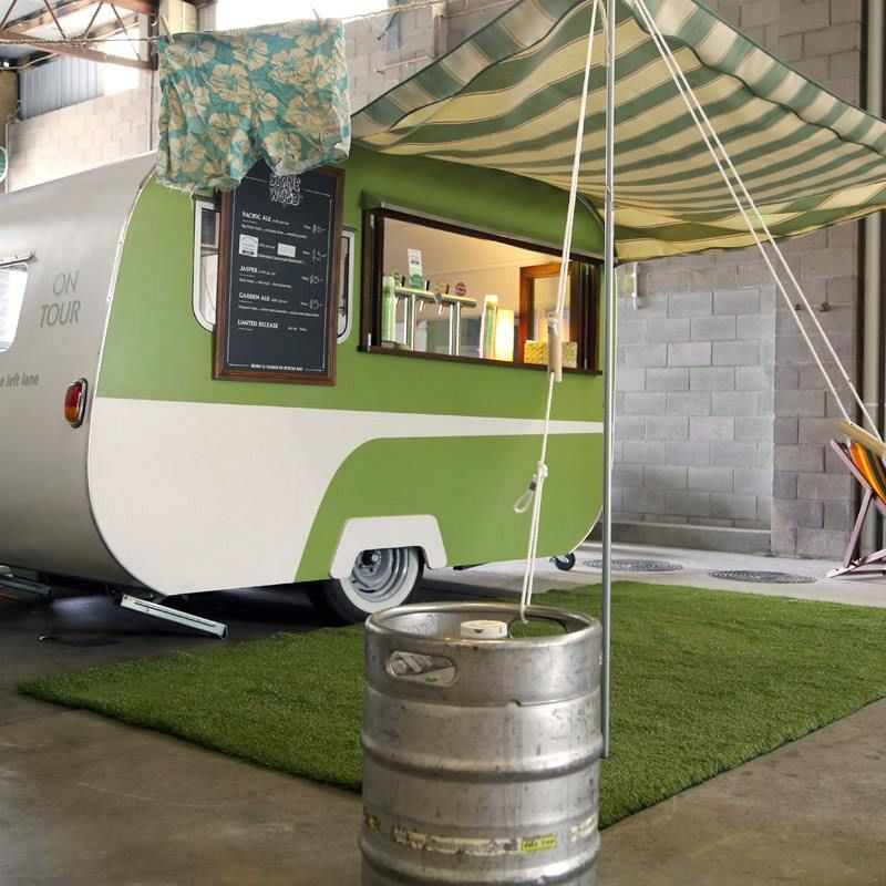 Old Camper + Awning + Old Kegs To Keep The Wind From