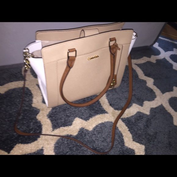 3fdcd65af4f SALEBrand new calvin klein purse Never used brand new and gorgeous! White  and brown with gold accents. Calvin Klein Bags