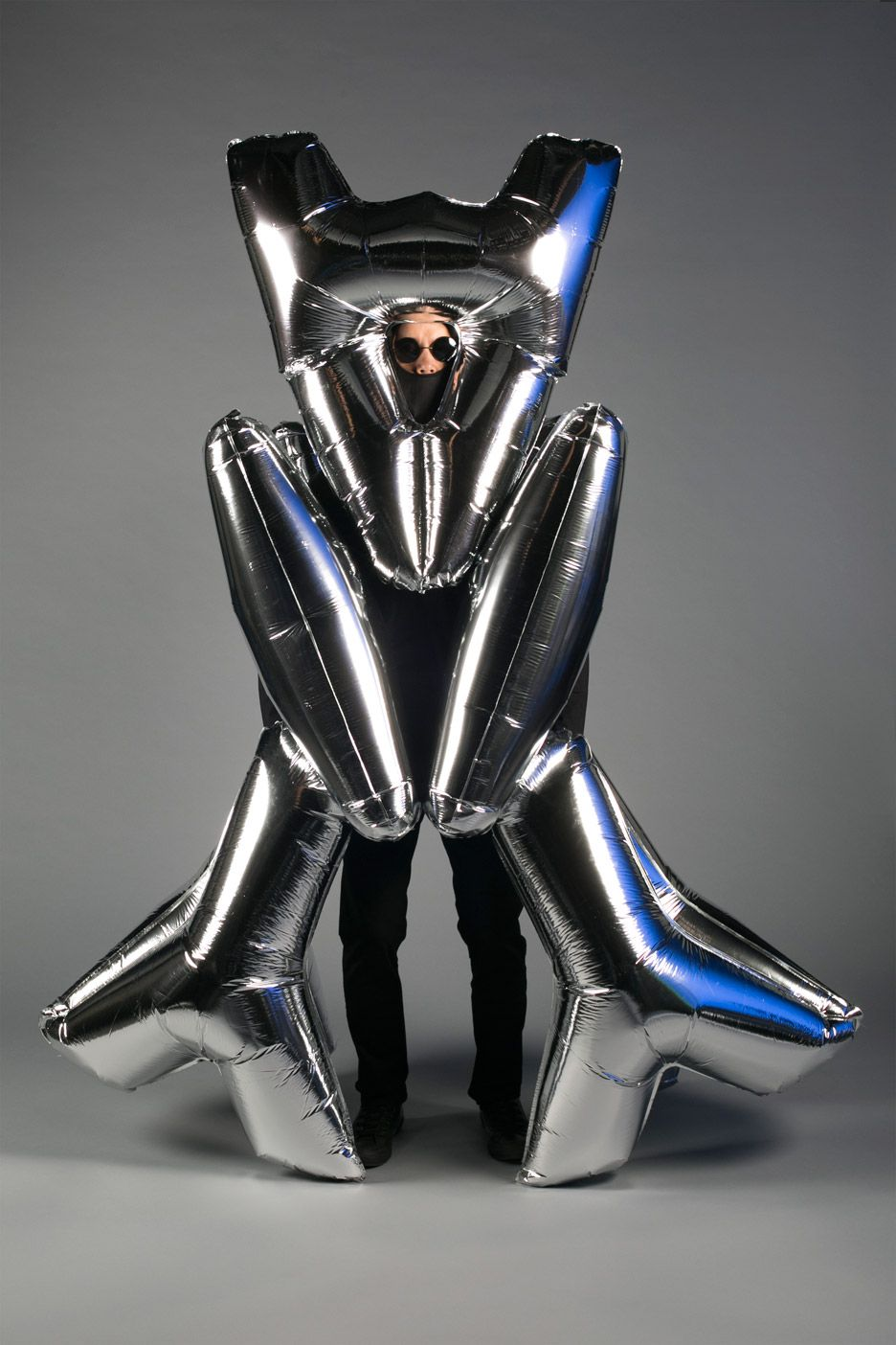 American designer Ken Tanabe has used a range of unusual materials, including balloons, to form alternative Halloween costumes.