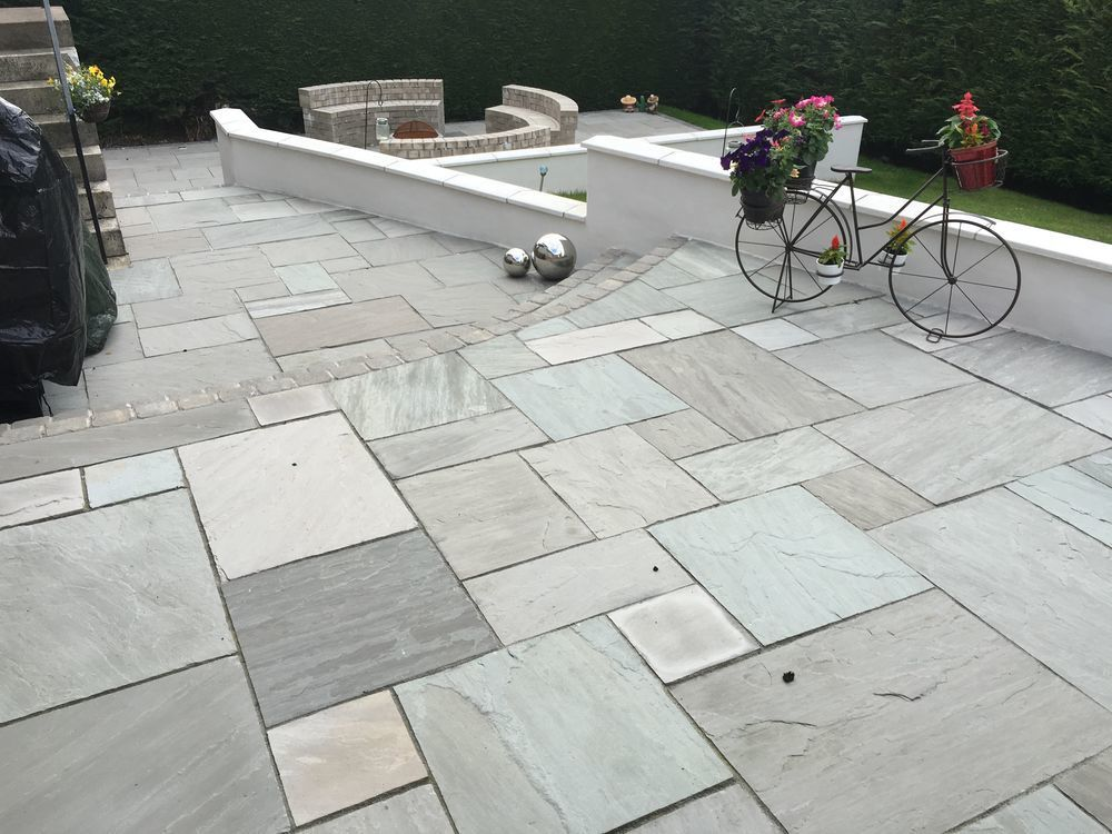Marshalls std Indian sandstone (grey-multi) with white rendered ...