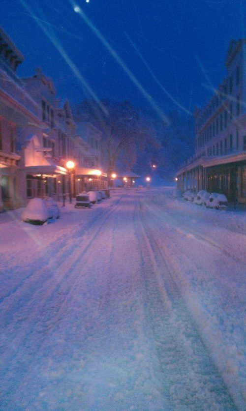 """Downtown looked pretty deserted. The snowmobiles parked along the street probably belong to folks who left the island for the night or weekend. When they return, they'll have to blow snow off their """"ride"""" before they can go home!"""