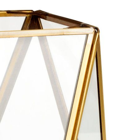 Gold-colored. Large clear glass lantern with a metal frame. Size approx. 5 x 5 x…