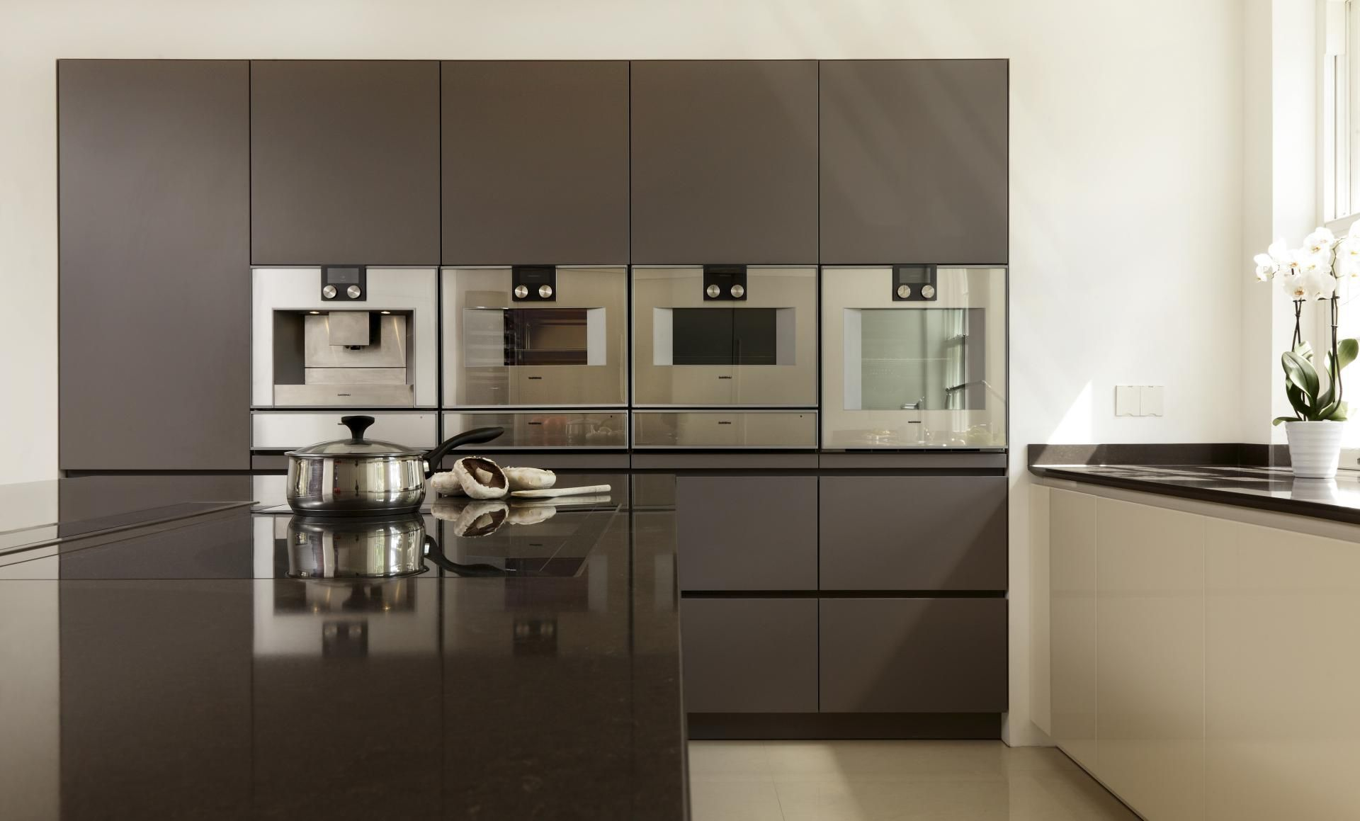A Sleek And Stylish Handleless Kitchen Design In Tactile Lava