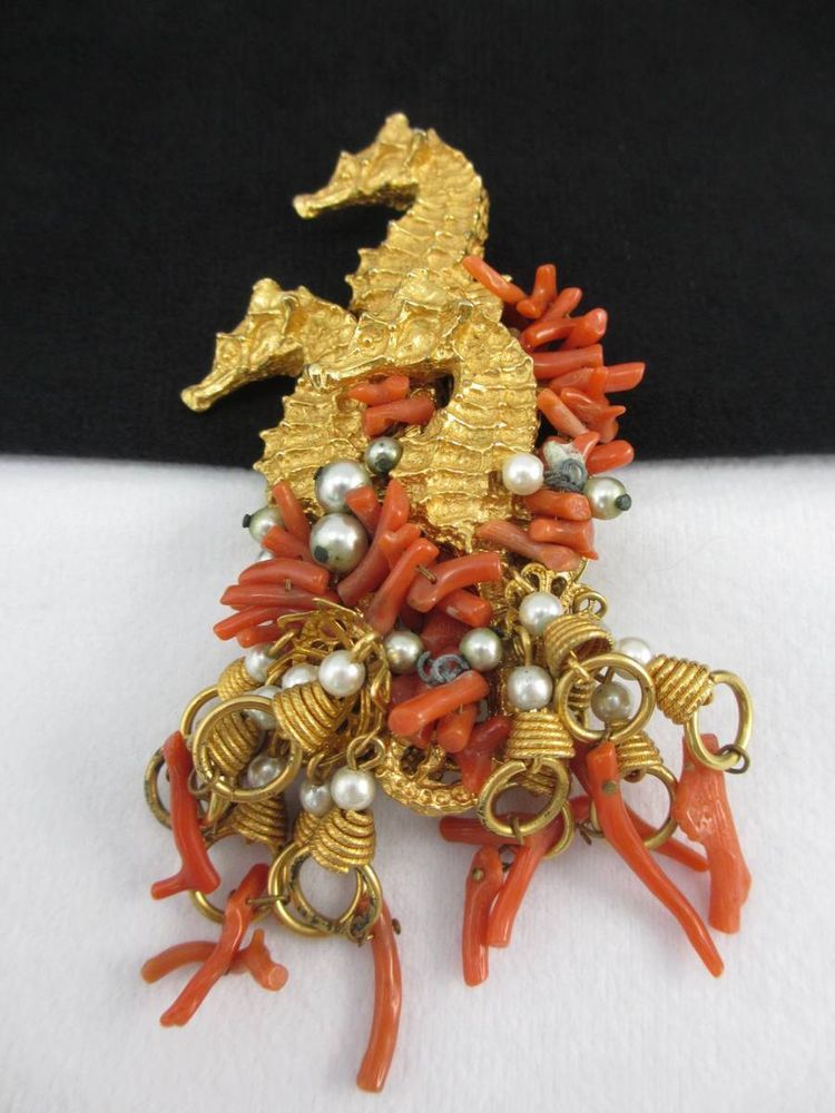 "William DeLillo Gold Tone Sea Horse Coral Pin This fabulous pin is gold tone w/ secure built in clasp.  The pin features a triple sea horse design with branch coral dangles.  The back is stamped deLillo.   Measurements: 4 3/8"" SOLD $155.49"