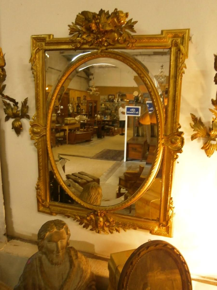 Mirror with #mirroded #panels in #giltwood and stucco. Period #NapoleonIII. Original gilding. #Beveled glasses. Nice birds decor. For sale on Proantic by Apparence.