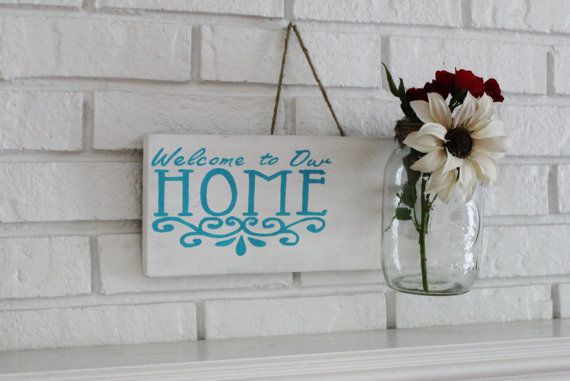 """This beautiful handmade, hand painted customizable rustic mason jar sign is a warm, and welcoming addition to any home! My """"Welcome to our Home"""" hanging mason jar sign makes a great gift for newlyweds and their first home together. A house warming gift, or even as something to add that special curb appeal to your home!  13long x 7tall You can personalize this by changing the colors of the sign to fit its new home. Or adding the family's last name!"""