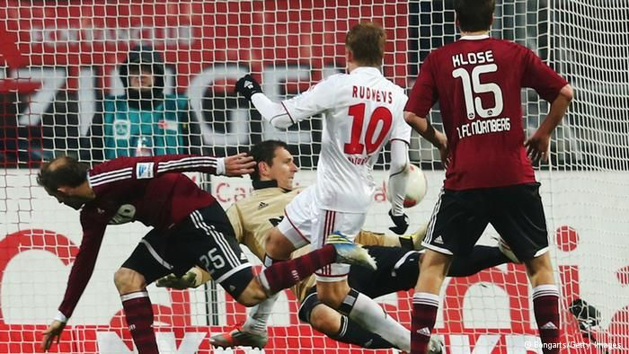 GettyImages 159767364  NUREMBERG, GERMANY - JANUARY 20: Artjoms Rudnevs (C) of Hamburg scores his team's first goal during the Bundesliga match between 1. FC Nuernberg and Hamburger SV at Easy Credit Stadium on January 20, 2013 in Nuremberg, Germany. (Photo by Alex Grimm/Bongarts/Getty Images)