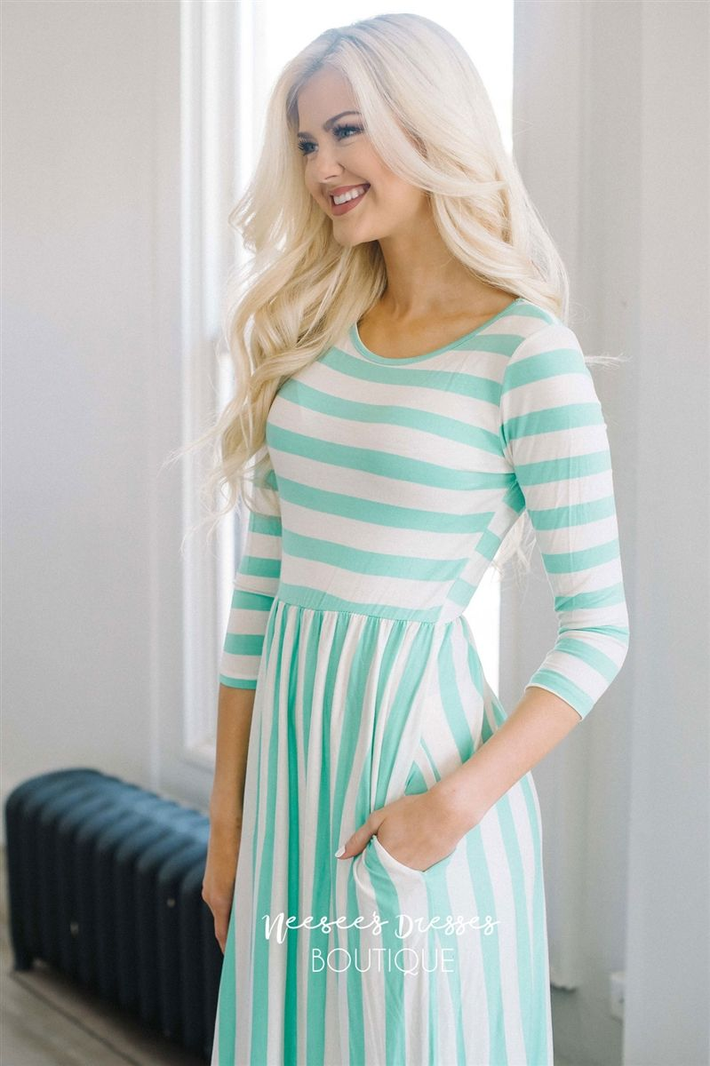 c89c94e98d5e How cute is this dress, and the material is so perfect for spring and  summer! Features mint and cream stripes, elastic waist and adorable front  pockets.