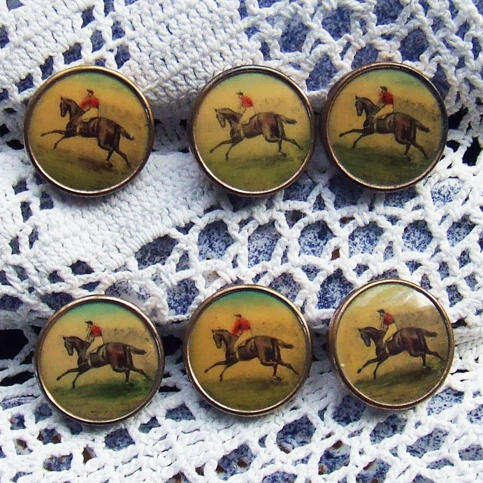 """Set of six English gentleman's antique waistcoat buttons. Each has a hand-colored lithograph of a race horse and a jockey in red and black striped racing silks. I believe they date from around 1880 - 1900. Each button is a shade over ½"""" diameter (14mm). SOLD $95.00 from France."""