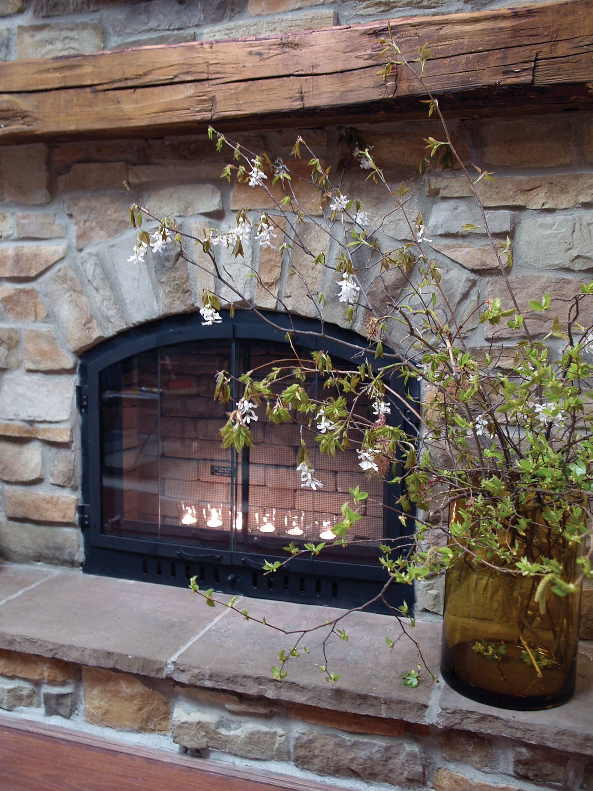 Rustic fireplace with country ledge stone veneer project of stone