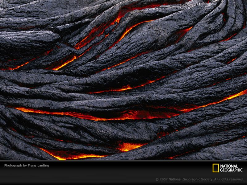 Pahoehoe lava darkens into ropy strands in Hawaii Volcanoes National Park.  Photograph by Frans Lanting