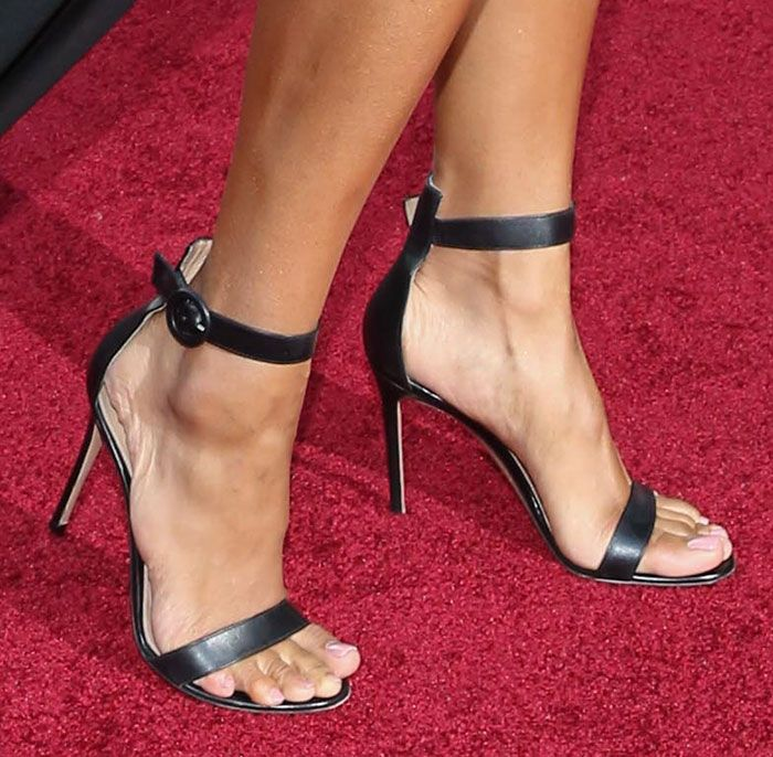 "3fe8a0988baf03 Ciara chose the classic red carpet-favorite Gianvito Rossi ""Portofino""  sandals for her feet. They are made of black leather and feature ankle  straps with ..."