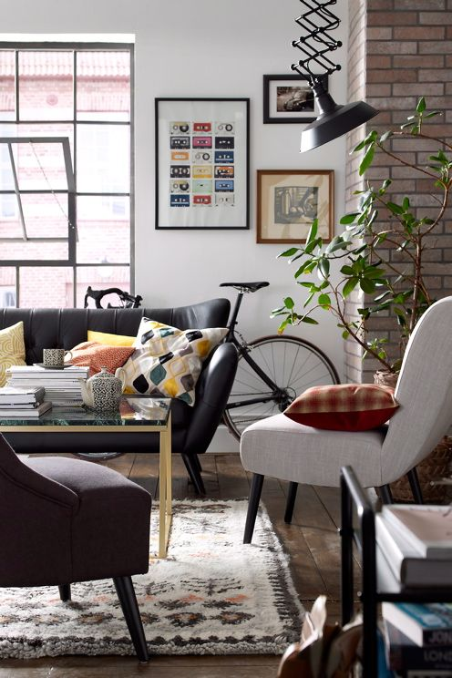 Deep reds and yellows give this urban living room a bit of a country cottage ambiance.
