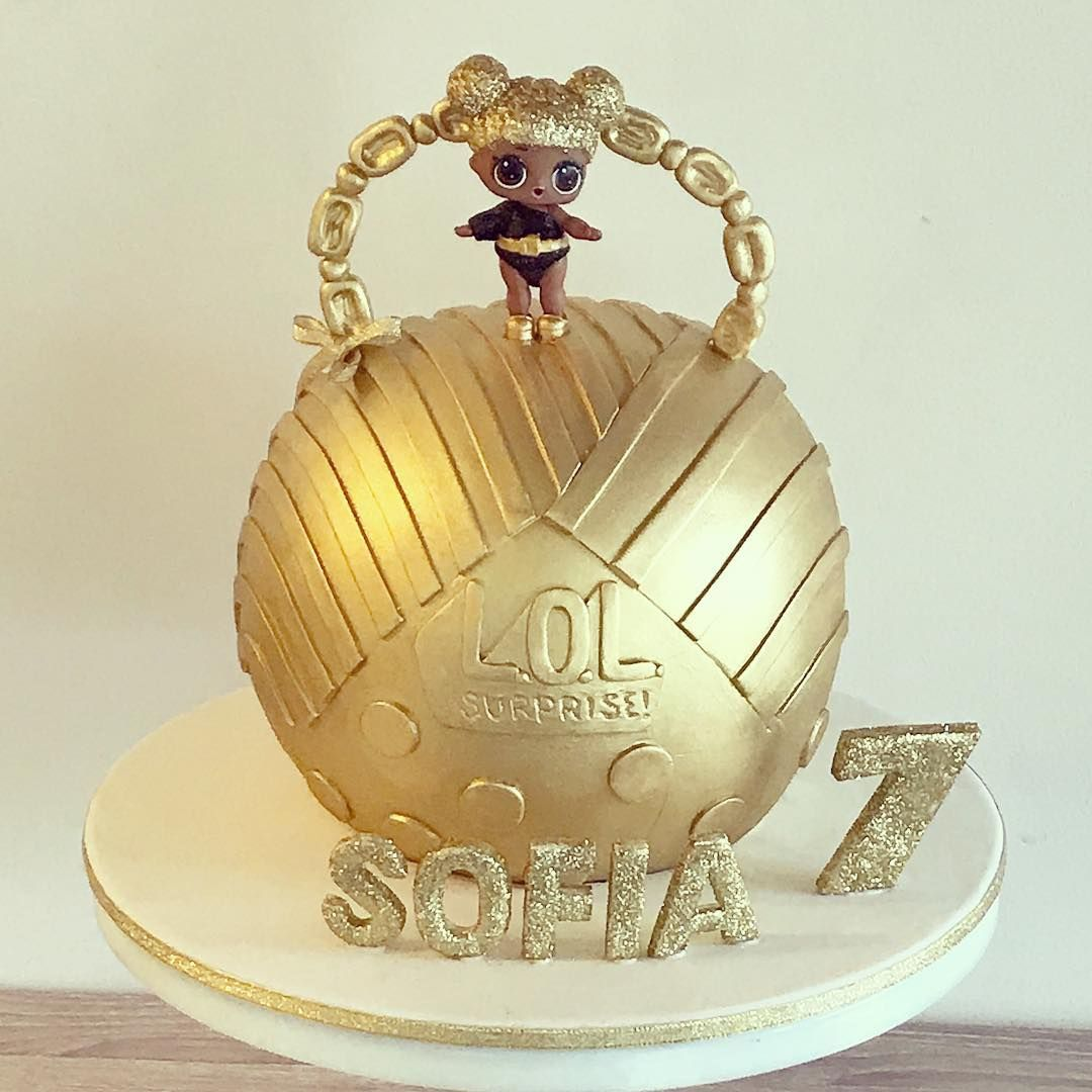 A cute gold lol surprise ball cake for sofias 7th birthday