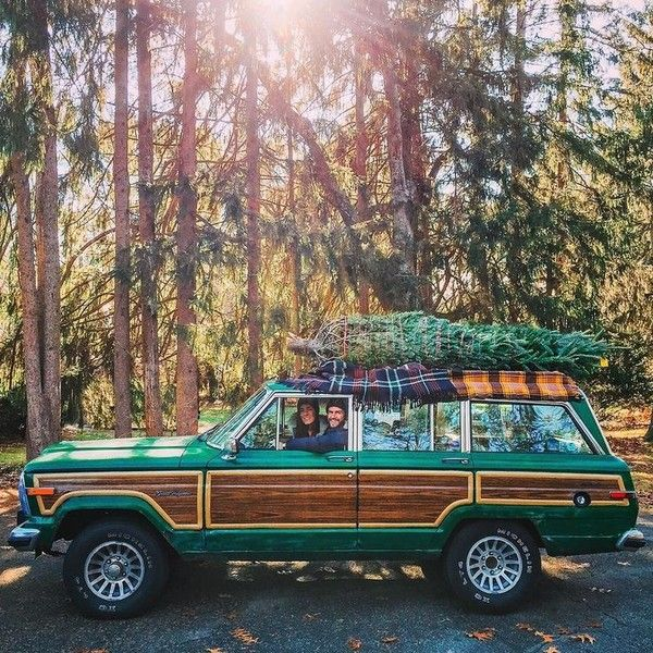 Christmas Jeepney.Classic Jeep Grand Wagoneer With Matching Christmas Tree
